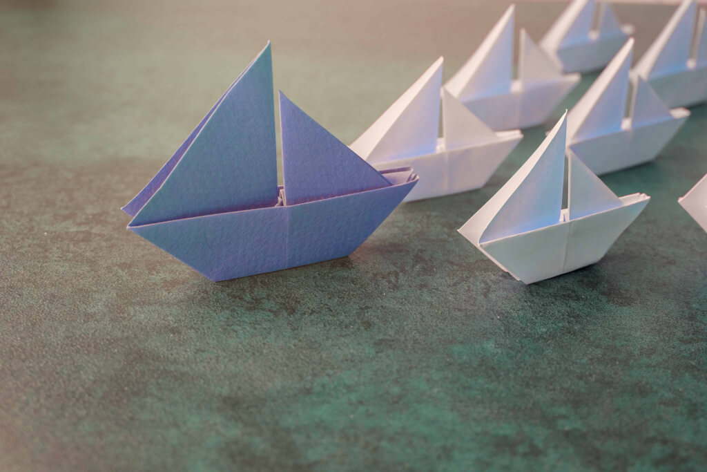 Origami paper sailboats, female woman leadership business concept, toning