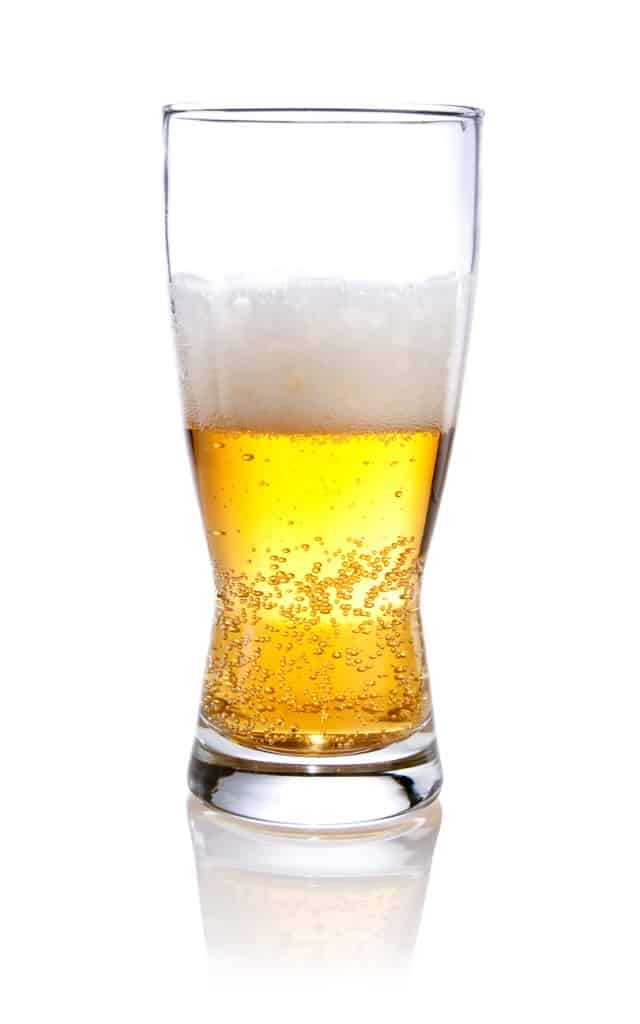 Half glass of beer on a Isolated white background