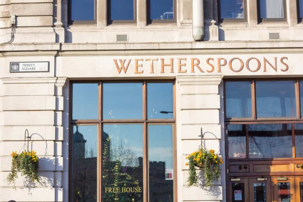 London, England - December 28, 2014: J D Wetherspoons is a restaurant chain established by Tim Martin in 1979. There are more than 800 pubs throughout the UK. Ths one is in Trinity Square on Tower Hill.
