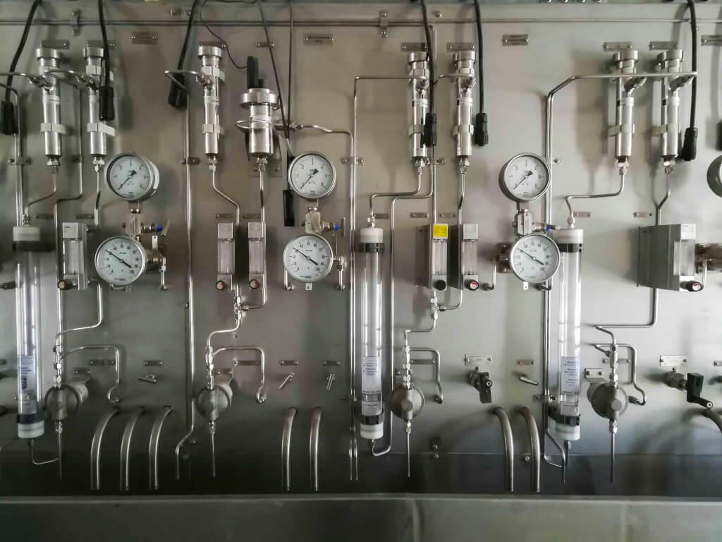 Steam and chemical sampling panel in sampling room of power plant