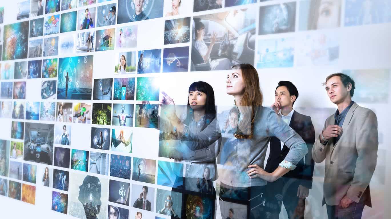 Group of people watching at a lot of pictures. Internet of Things. Information communication technology.
