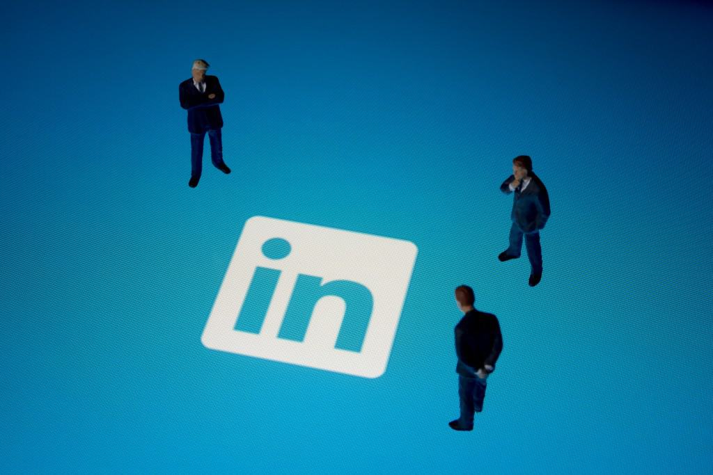 Seoul, korea - August 9, 2014 : Businessman figurines & Linkedin logo on Apple iPad. Linkedin is a business-related social networking website.