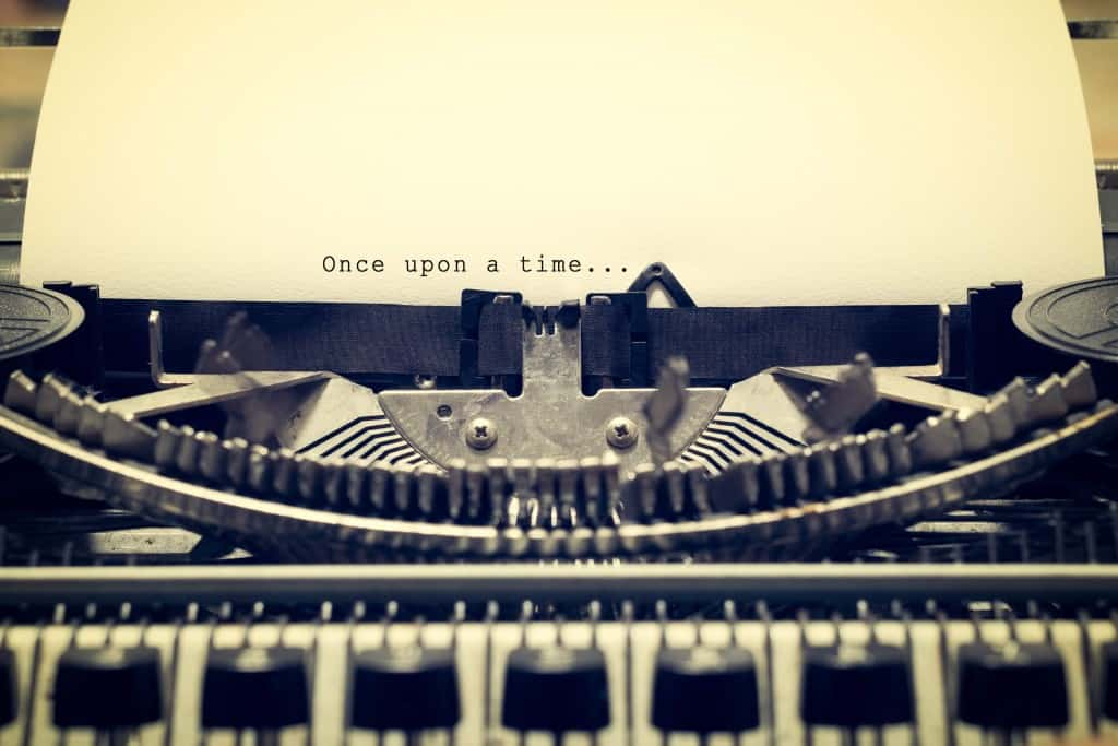 """Words """"Once upon a Time"""" written with old typewriter on white paper in vintage style"""