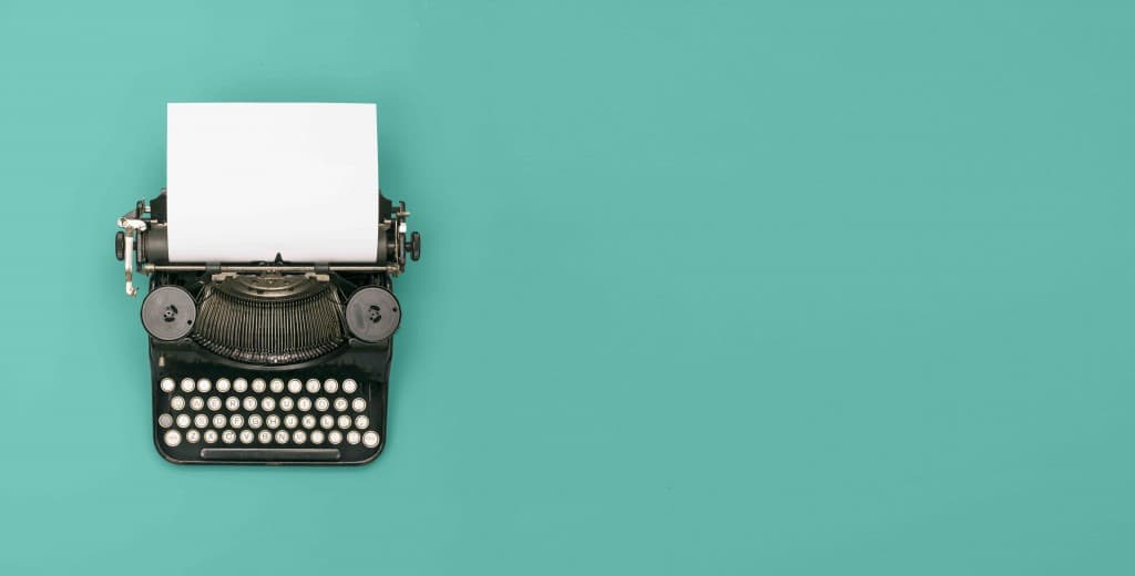 top view retro black typewriter with paper header with text space